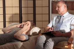 43668673 - image of woman lying on couch in psychiatrist office